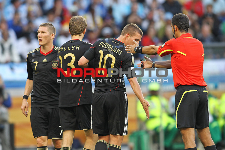 03.07.2010, CAPE TOWN, SOUTH AFRICA, im Bild <br /> Referee Ravshan Irmatov (UZB) tells the German wall of Bastian Schweinsteiger, Thomas Mueller and Lukas Podolski to move back during the Quarter Final, Match 59 of the 2010 FIFA World Cup, Argentina vs Germany held at the Cape Town Stadium.<br /> Foto &copy;  nph /  Kokenge *** Local Caption *** Fotos sind ohne vorherigen schriftliche Zustimmung ausschliesslich f&uuml;r redaktionelle Publikationszwecke zu verwenden.<br /> <br /> Auf Anfrage in hoeherer Qualitaet/Aufloesung