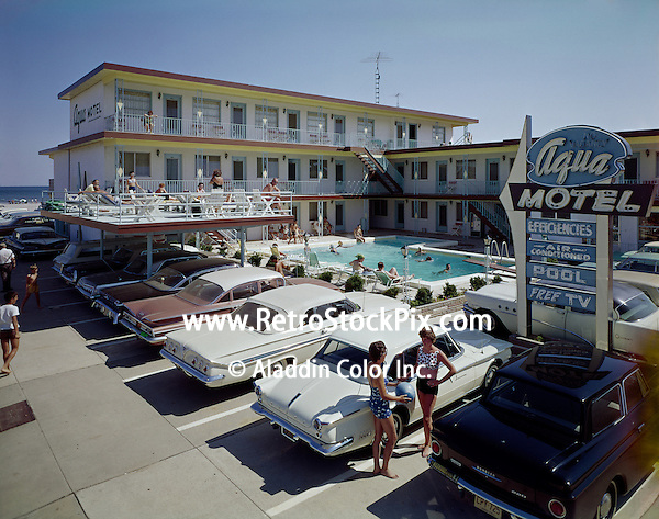 Aqua Motel in Wildwood, NJ. Old neon sign and cars in front of the motel.