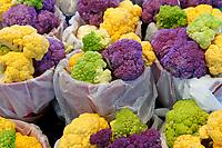 Multicolored purple, yellow, and green cauliflower heads for sale at the Jean Talon public market or Marche Jean Talon, Montreal, Quebec, Canada