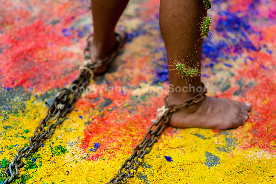 A chained Catholic devotee, with cactus spines stuck to his leg, walks on a colorful sawdust carpet during the Holy week penitential procession in Atlixco, Mexico, 30 March 2018. Every year on Good Friday, dozens of anonymous men of all ages voluntarily undergo pain and suffering during the religious procession of the 'Engrillados' (the Shackled ones) in Puebla state, central Mexico. Wearing heavy chains on their shoulders covered with prickling cacti while being burned by the hot midday sun, they recall Jesus Christ's death by crucifixion and demonstrate their religiosity and faith.
