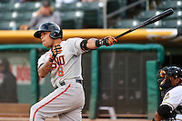 Javier Herrera (8) of the Fresno Grizzlies at bat against the Salt Lake Bees at Smith's Ballpark on April 9, 2014 in Salt Lake City, Utah.  (Stephen Smith/Four Seam Images)