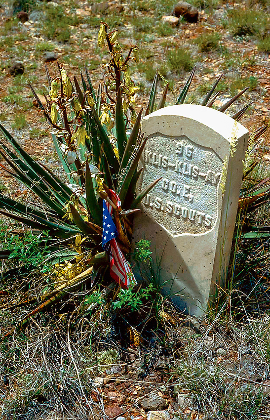 The grave of an Apache Scout, one of many who served with the U.S. Cavalry during the Indian Wars to bring renegade Apaches like Geronimo back to live on the reservation. This graveyard today is shared by many Apache and several ranking officers who died trying to end the last outbreak of violence between the U.S. and a native American tribe closing a final chapter of the old west