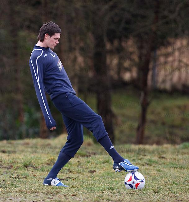 Kyle Lafferty retrieves the ball from a mudbath at Murray Park