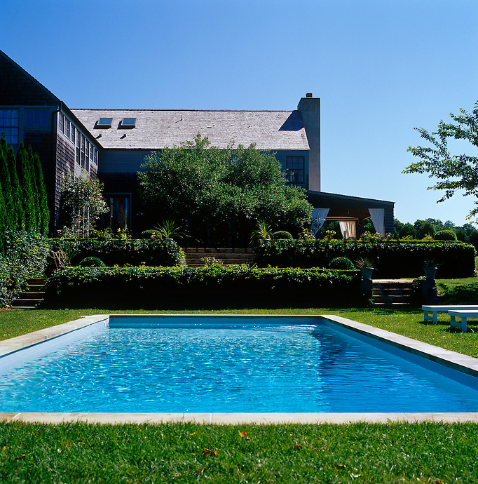 The lawn closest to the house is dominated by an outdoor swimming pool