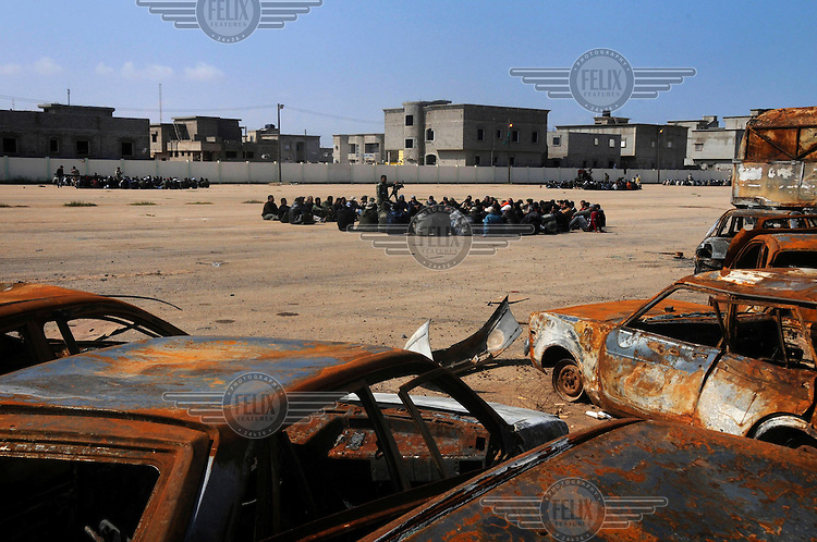 A training centre for army recruits in Benghazi near a dump for burnt out cars. On 17 February 2011 Libya saw the beginnings of a revolution against the 41 year regime of Col Muammar Gaddafi.