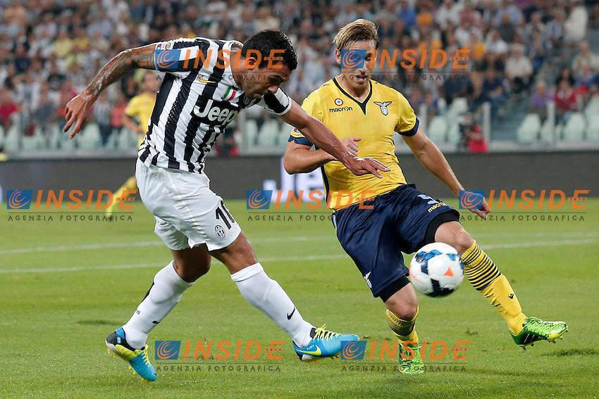 Carlos Tevez Juventus, Lucas Biglia Lazio,<br /> Torino 31-08-2013<br /> Juventus Stadium <br /> Football Calcio 2013/2014 Serie A <br /> Juventus - Lazio <br /> Foto Marco Bertorello Insidefoto