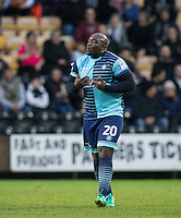Adebayo Akinfenwa of Wycombe Wanderers protests his innocence during the Sky Bet League 2 match between Notts County and Wycombe Wanderers at Meadow Lane, Nottingham, England on 10 December 2016. Photo by Andy Rowland.
