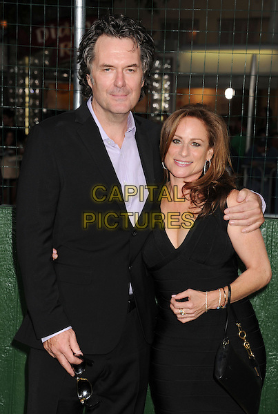"Randy Brown, Michele Weisler.""Trouble With The Curve"" Los Angeles Premiere held at the Regency Village Theatre, Westwood, California, USA..September 19th, 2012.half length black suit purple shirt dress .CAP/ROT/TM.©Tony Michaels/Roth Stock/Capital Pictures"