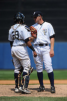 Staten Island Yankees pitcher Dietrich Enns (21) and catcher Isaias Tejeda (29) during game against the Auburn Doubledays at Richmond County Bank Ballpark at St.George on August 2, 2012 in Staten Island, NY.  Auburn defeated Staten Island 11-3.  Tomasso DeRosa/Four Seam Images