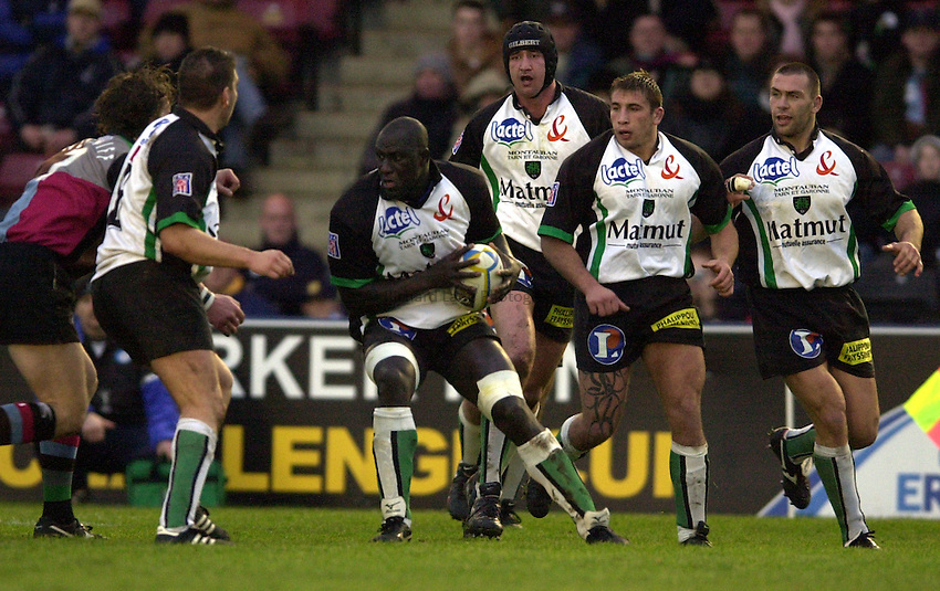 Photo. Peter Spurrier.Parker Pen Challenge Cup 17/01/2004 Harlequins v Montauban.Yogane Correa holds the ball as Quins move in....