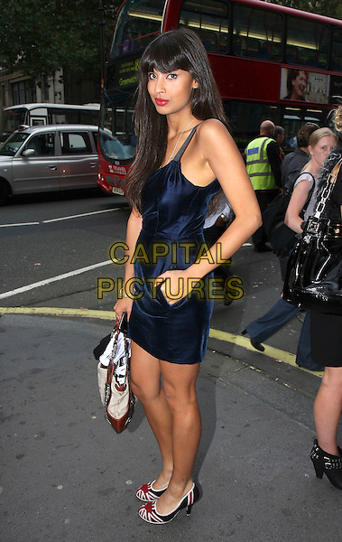 JAMEELA JAMIL .Spotted during London Fashion Week Day 2, London, England, UK,.September 19th 2009..full length navy blue dress union jack shoes red flag hand in pocket beige brown bag .CAP/MAR.© Martin Harris/Capital Pictures.