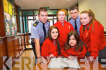 Elaine Parker, Sophie Keane, Ava Doherty and Rebecca O'Sullivan, Holy Cross Mercy School, Killarney pictured with Garda Eddie Walsh and Garda Jamie Lenihan as they signed the book of Condolance for detective Garda Adrian O'Donohue in Killarney Garda Station on Tuesday.