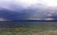 WEATHER PICTURE<br />Two swimmers in the sea as dark clouds and rain seen over the bay of south Evia minutes before a monsoon type storm hits Nireas beach near Aliveri on the island of Evia, Greece. The country has been experiencing recent heatwaves. Thursday 27 July 2017