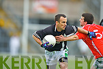 Derek Pyne Legion goes past Kieran Murphy Listry during the East Kerry semi final in Fitzgerald Stadium on Sunday