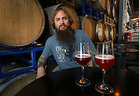 August 8, 2016. I Vista, CA. USA.   Toolbox Brewing's Head Brewer Ehren Schmidt with House Blend Blueberry, left, and Pinkies Up beer.   Photos by Jamie Scott Lytle. Copyright.