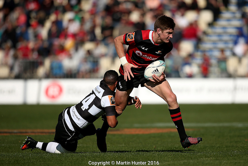 Jordie Barrett of Canterbury is tackled by Ryan Tongia of Hawkes Bay during the Mitre 10 Cup national provincial championship match between Canterbury and Hawkes Bay at AMI Stadium, Christchurch, New Zealand on Sunday, 11 September 2016. Photo: Martin Hunter/ lintottphoto.co.nz