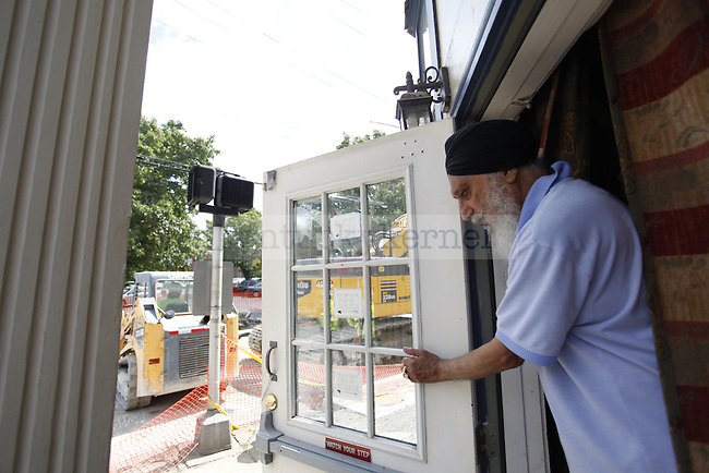 B.S. Sidhu closes the door in response to the construction Tuesday afternoon at the Bombay Brazier Indian Restaurant  on the corner of South Limestone and East High...PHOTO BY ZACH BRAKE I STAFF