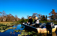 Mother and son fishing at Blue Cypress Lake in Florida on a chilly January morning. Model released