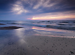 Lake Huron sandy shore beautiful sunset nature scenery. Pinery Provincial Park, Ontario, Canada.