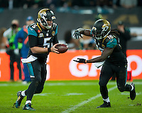 09.11.2014.  London, England.  NFL International Series. Jacksonville Jaguars versus Dallas Cowboys. Jacksonville Jaguars' Quarterback Blake Bortles (#5) to Jacksonville Jaguars' Running Back Denard Robinson (#16)