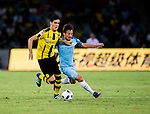 Borussia Dortmund midfielder Mikel Merino (l) tries to defend Manchester City midfielder David Silva (c) during an attack of City against Borussia Dortmund at the 2016 International Champions Cup China match at the Shenzhen Stadium on 28 July 2016 in Shenzhen, China. Photo by Marcio Machado / Power Sport Images