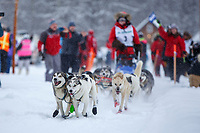 Lara Anne Renner 's lead dogs lunge out of the chute during the start of the 2018 Junior Iditarod Sled Dog Race on Knik Lake in Southcentral, Alaska.  Saturday February 24, 2018<br /> <br /> Photo by Jeff Schultz/SchultzPhoto.com  (C) 2018  ALL RIGHTS RESERVED