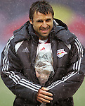15 April 2007: New York's Dema Kovalenko tries to keep the youngster who entered the field with him for team introductions warm and dry. The New York Red Bulls defeated FC Dallas 3-0 at Giants Stadium in East Rutherford, New Jersey in an MLS Regular Season game.