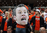 A fan holds up a cut out of Virginia forward Evan Nolte (11) during the game against Clemson Thursday in Charlottesville, VA.
