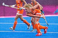 29 JUL 2012 - LONDON, GBR - Caia van Maasakker (NED) of Netherlands shoots during the women's London 2012 Olympic Games Preliminary round hockey match against Belgium at the Riverbank Arena in the Olympic Park in Stratford, London, Great Britain .(PHOTO (C) 2012 NIGEL FARROW)