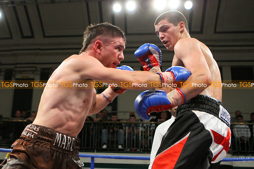 Billy Morgan (black/red shorts) defeats Marc Callaghan in a Lightweight boxing contest at York Hall, Bethnal Green, promoted by Queensberry Promotions - 18/11/11 - MANDATORY CREDIT: Gavin Ellis/TGSPHOTO - Self billing applies where appropriate - 0845 094 6026 - contact@tgsphoto.co.uk - NO UNPAID USE.