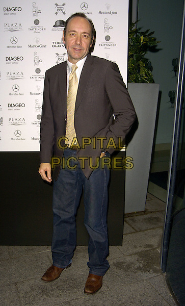 KEVIN SPACEY.At The 24 Hour Plays - Celebrity Gala,.The Old Vic Theatre, London, England, .October 8th 2006..full length gold yellow tie jeans jacket.Ref: CAN.www.capitalpictures.com.sales@capitalpictures.com.©Can Nguyen/Capital Pictures