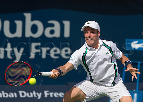 23.02.2016. Dubai UAE.  Roberto Bautista returns to Agut (ESP) at the Dubai Duty Free Tennis Championships Dubai, United Arab Emirates - 23 February 2016.