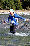NELSON LAKES, NEW ZEALAND - APRIL 18: Jennifer McBride crosses the Travers River during the 2015 Alpine Lodge Loop The Lake trail run at Lake Rotoiti on April 18 16, 2015 in Nelson, New Zealand. (Photo by Marc Palmano/Shuttersport Limited)