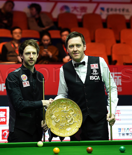03.04.2016. Beijing, China.  Judd Trump (L) of England and his compatriot Ricky Walden shake hands ahead of the final at the 2016 World Snooker China Open in Beijing,  China, April 3, 2016.