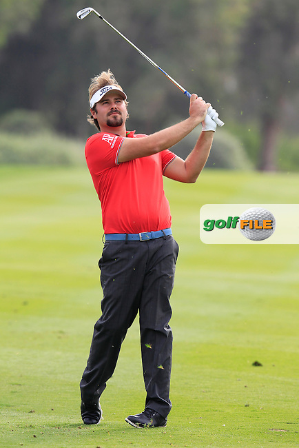 Victor Dubuisson (FRA) plays his 2nd shot on the 13th hole during Sunday's Final Round of the Abu Dhabi HSBC Golf Championship 2015 held at the Abu Dhabi Golf Course, United Arab Emirates. 18th January 2015.<br /> Picture: Eoin Clarke www.golffile.ie
