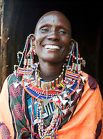 Maasai tribeswoman in traditional Maasai clothing, Tipilit Village near Amboseli National Park, Kenya