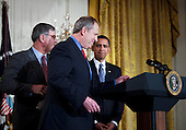 Washington, DC - January 28, 2009 -- United States President Barack Obama (R) and Sam Palmisano (L), Chairman, CEO and President of IBM, watch as David M. Cote (C), Chairman and CEO of Honeywell, steps up to the lectern in the East Room of the White House, Wednesday, January 28, 2009 in Washington DC.  President Obama spoke after meeting with business leaders about the state of the US economy..Credit: Brendan Smialowski - Pool via CNP