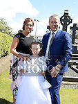Emily Halton who received first holy communion in the Church of the Assumption in Tullyallen pictured with parents David and Isabelle. Photo:Colin Bell/pressphotos.ie