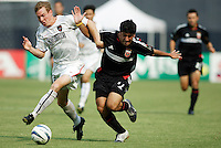 The MetroStars' Chris Leitch attempts to slow down D.C. United's Alecko Eskandarian who connected for two goals. D.C. United defeated the NY/NJ MetroStars 6 to 2 at RFK Stadium, Washington, D.C., on July 3, 2004.