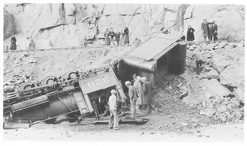 D&amp;RGW #320 wrecked and inverted down the bank into the Gunnison River two miles east of Sapinero.  Several spectators are inspecting the damage, some up close.<br /> D&amp;RGW  2 miles e. of Sapinero, CO  2/16/1934