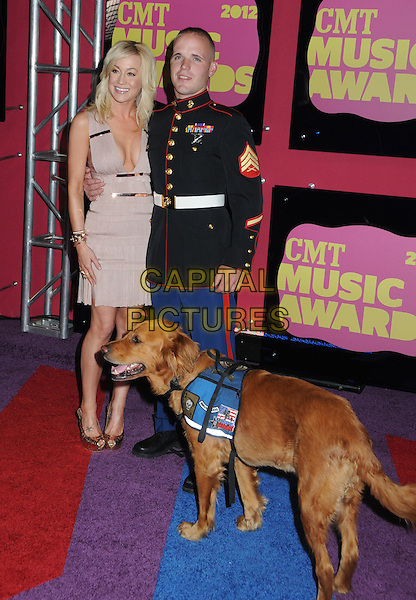 Kellie Pickler & guest.2012 CMT Music Awards held at Bridgestone Arena, Nashville, Tennessee, USA..June 6th, 2012.full length beige pink dress low cut neckline cleavage black uniform dog animal.CAP/ADM/LF.©Laura Farr/AdMedia/Capital Pictures.