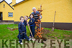 l-r  Daniel Collins, Sean Crean and Lauren Collins helping to plant a tree to mark the Retirement of Michael Herlihy who is retiring from LoughFouder NS, Knocknagoshel after 29 years service