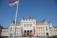 Hungary's flag is seen raised in front of the Parliament during a ceremony on the Hungarian national holiday celebrating the foundation of the State in Budapest, Hungary  on Aug. 20, 2018. ATTILA VOLGYI