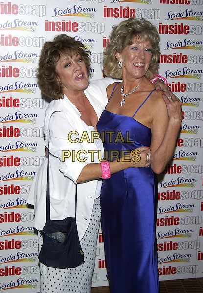 AMANDA BARRIE & SUE NICHOLLS.Inside Soap Awards Party, La Rascasse, Cafe Grand Prix, London, September 27th 2004..half length funny.Ref: PL.www.capitalpictures.com.sales@capitalpictures.com.©Capital Pictures.