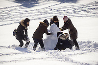 Visitors to Central Park attempt to construct a snowman in the aftermath of Winter Storm Jonas on Sunday, January 24, 2016. The blizzard dumped 26.8 inches onto Central Park making it the second-highest amount since records started in 1869.  (© Richard B. Levine)