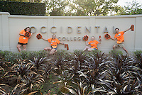 Main entrance, Mullin Grove sign. Members of the O-Team work hard to welcome incoming Occidental College students, the class of 2020, during Orientation, Aug. 25, 2016.<br /> (Photo by Marc Campos, Occidental College Photographer)