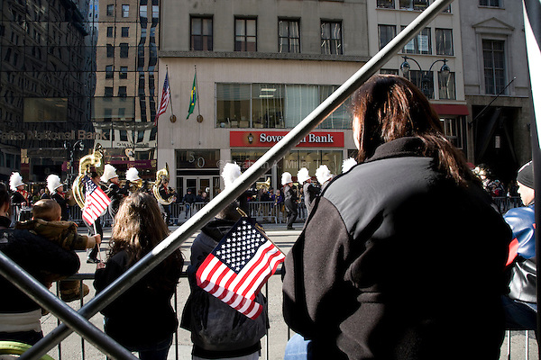 Crowds watch active officers, various veteran's groups, junior ROTC members, and the families of veterans participate in the annual Veteran's Day Parade along Fifth Avenue in Manhattan, New York on 11 November 2011.