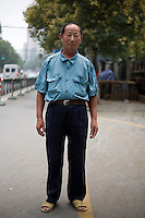 Jiangyanfeng, no occupation given, age not given, poses for a portrait in Nanjing. Response to 'What does China mean to you?': 'My home country.'  Response to 'What is your role in China's future?': '[no answer]'