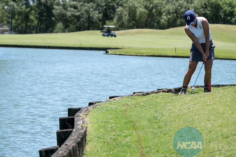 HOUSTON, TX - MAY 12: Iris Kawada of George Fox University hits near a water hazard on the 11th hole during the Division III Women's Golf Championship held at Bay Oaks Country Club on May 12, 2017 in Houston, Texas. (Photo by Rudy Gonzalez/NCAA Photos/NCAA Photos via Getty Images)