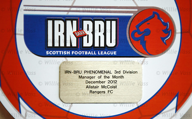 Rangers manager Ally McCoist picks up his award for Manager of the Month for December